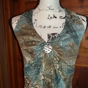 Unique sleeveless blouse with sparkle!